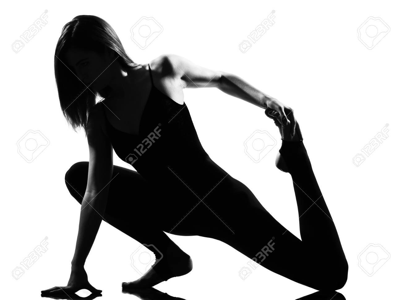 beautiful caucasian tall woman ballet dancer stretching warming up full length on studio isolated white background Stock Photo - 9800060