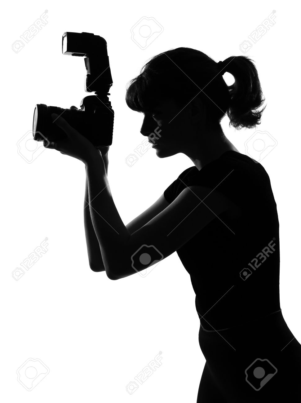 portrait silhouette in shadow of a young woman photographer holding a camera  in studio on white background isolated Stock Photo - 9800024