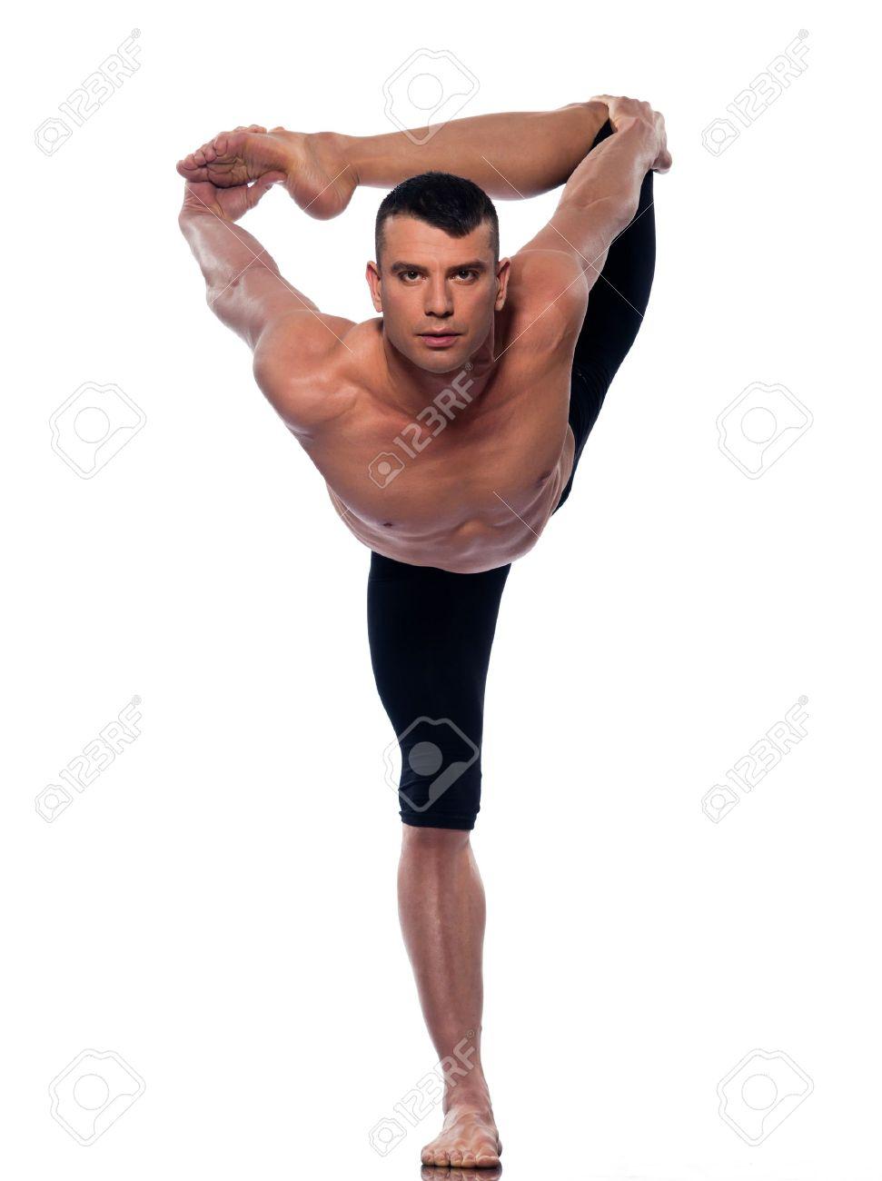 caucasian Man yoga asanas natarajasana dancer pose gymnastic..