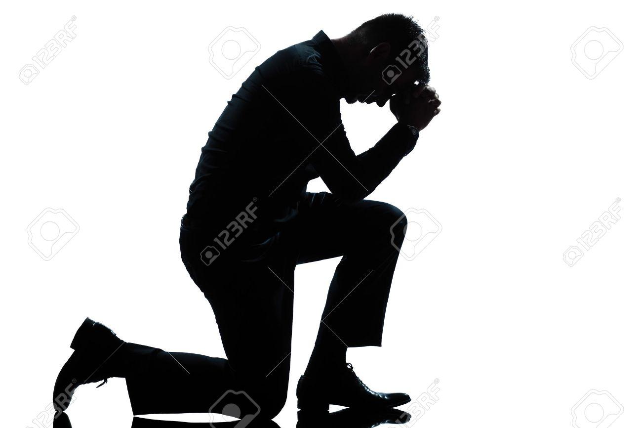 one caucasian man kneeling sadness praying full length silhouette in studio isolated white background Stock Photo - 11605339