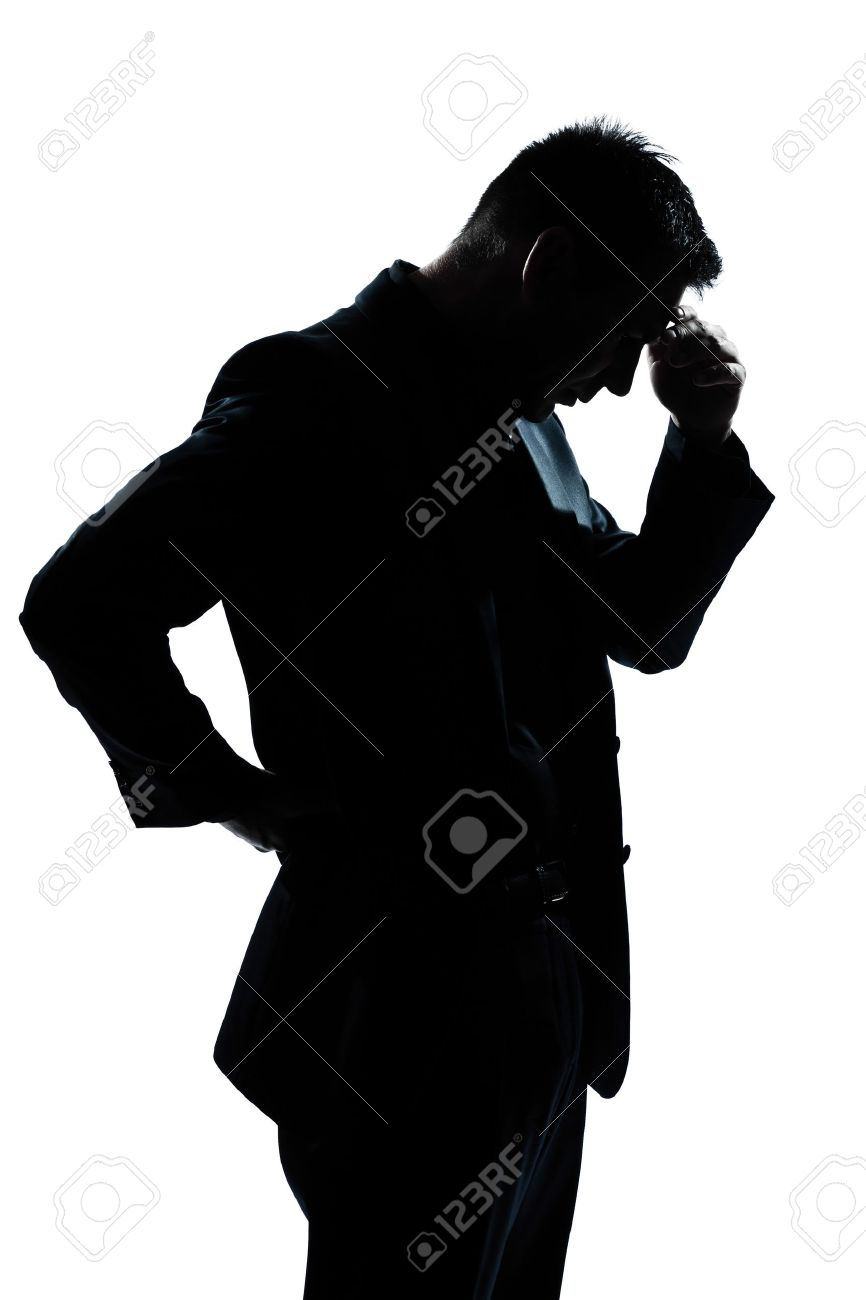 one caucasian man portrait silhouette thinking looking down in studio isolated white background Stock Photo - 11611382