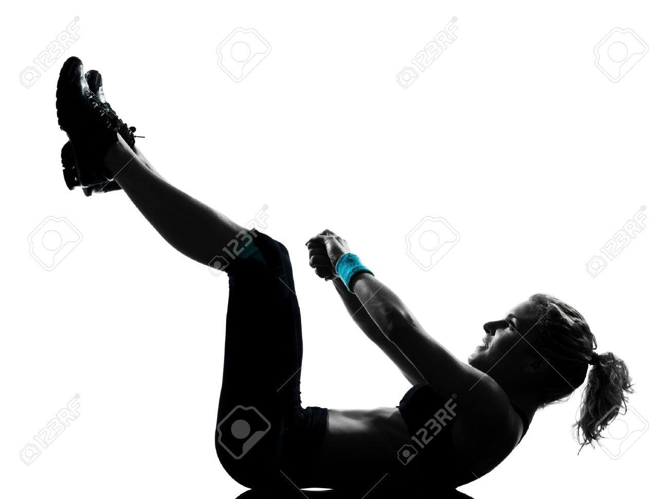 one woman exercising workout fitness aerobic exercise abdominals push ups posture on studio isolated white background Stock Photo - 11753070