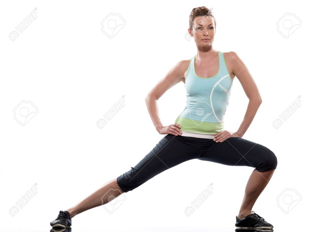 stretching workout posture by a woman on studio white background Stock Photo - 11766137