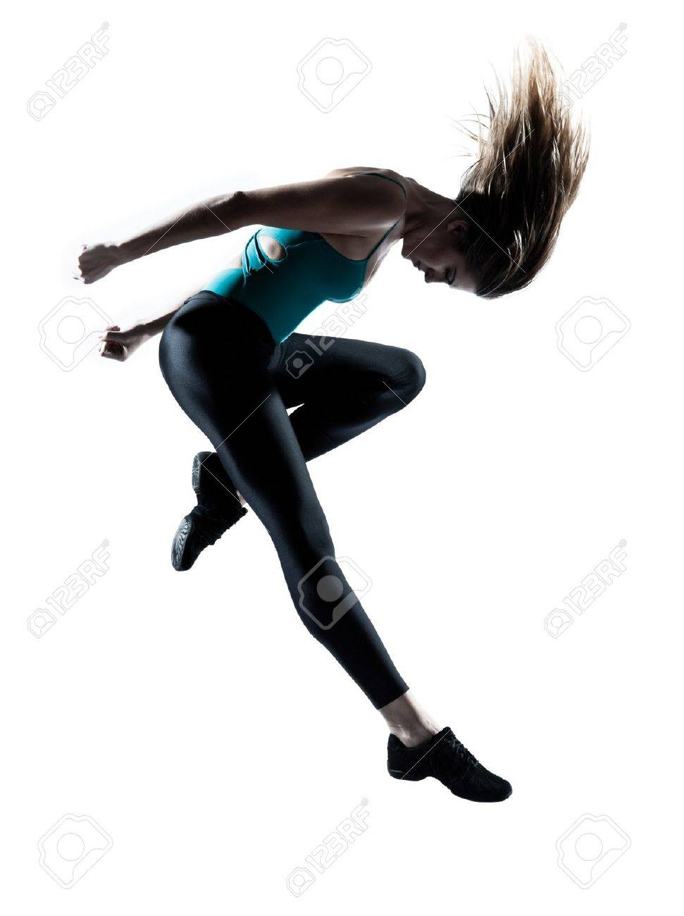 Side view of a young beautiful girl doing gymnastic jump in studio on white background Stock Photo - 11752585