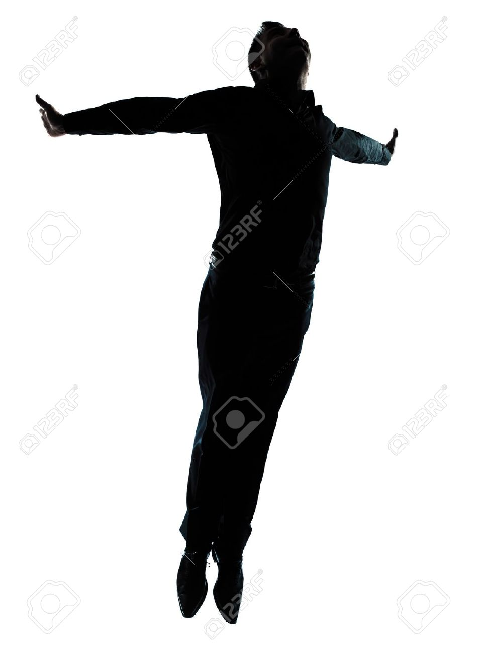 one caucasian business man  jumping flying wellness silhouette Full length in studio isolated on white background Stock Photo - 11752676