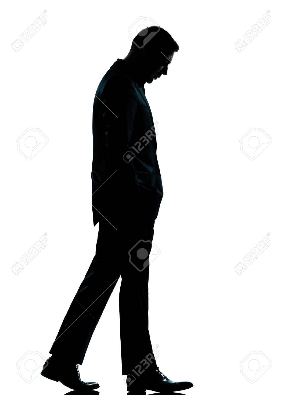one caucasian business man walking silhouette Full length in studio isolated on white background Stock Photo - 11752730