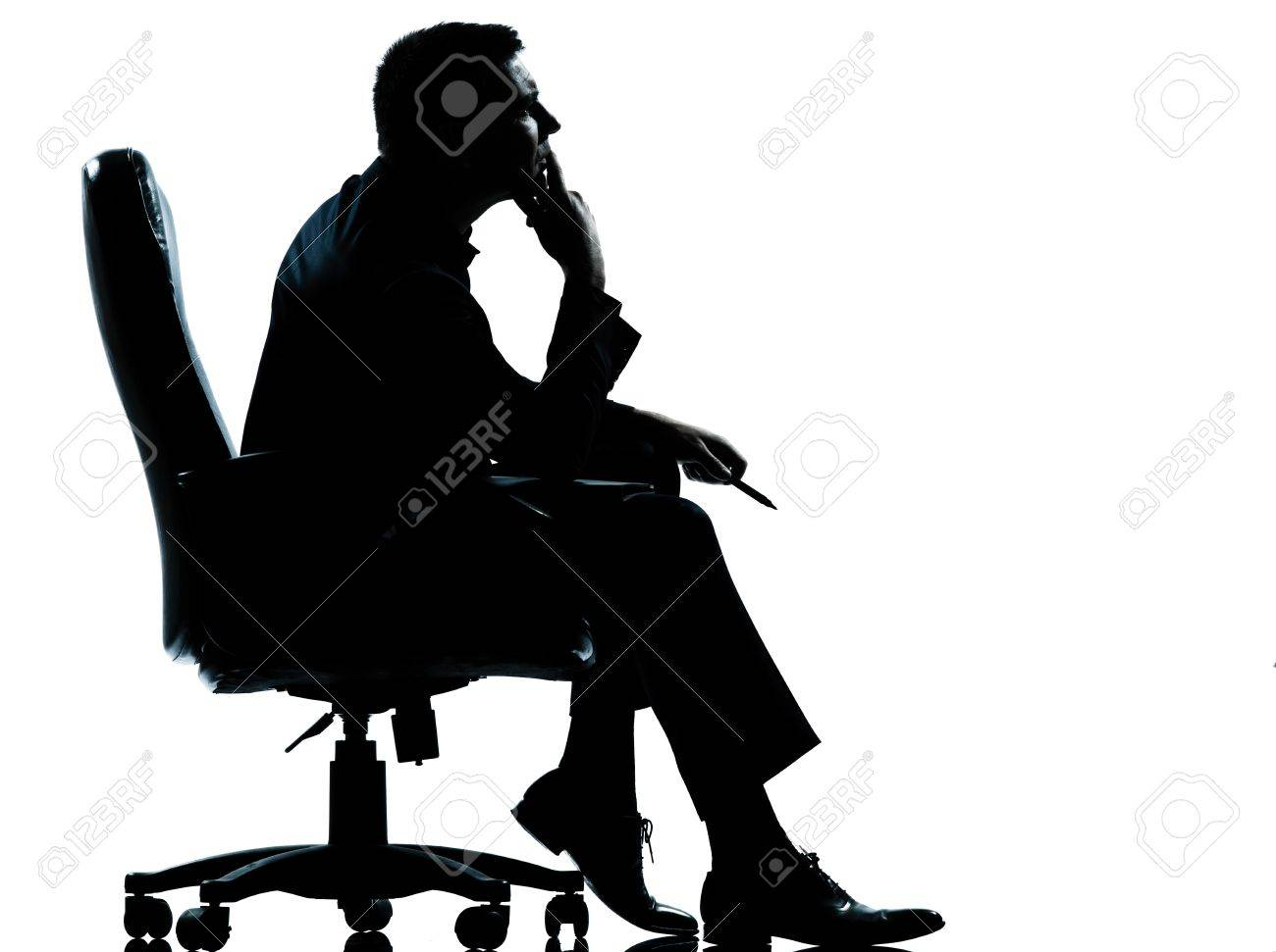 one caucasian business man sitting in armchair silhouette Full length in studio isolated on white background Stock Photo - 11752696