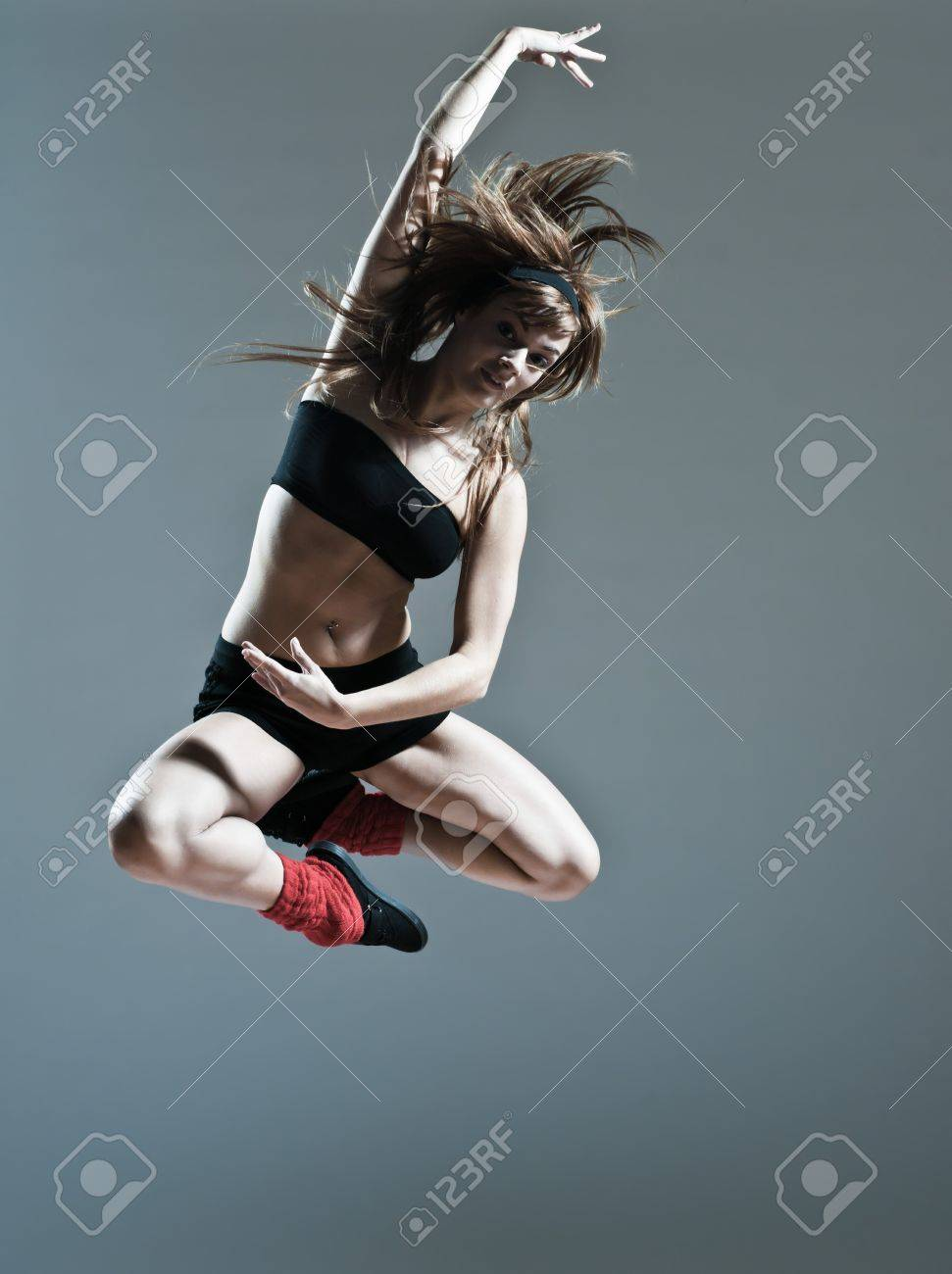 beautiful young caucasian woman girl dancer ballet breakdance leap jump on studio isolated background Stock Photo - 11766217