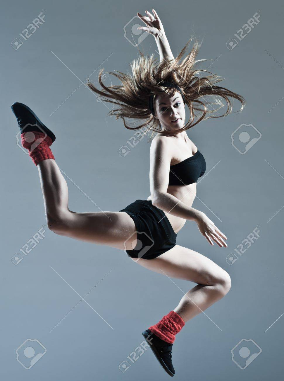 beautiful young caucasian woman girl dancer ballet breakdance leap jump on studio isolated background Stock Photo - 11766220