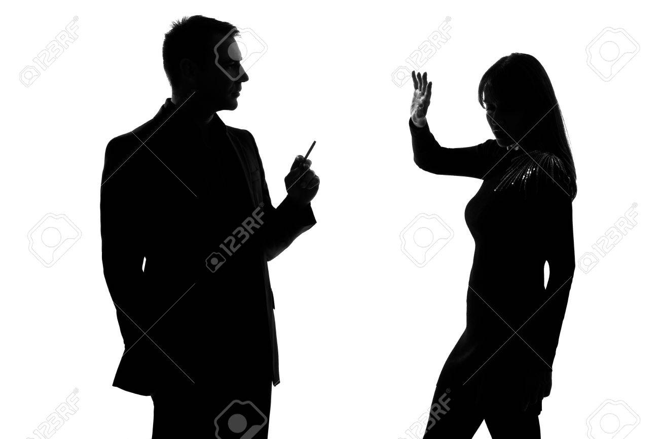 one caucasian couple man smoking cigarette and woman disturbed in studio silhouette isolated on white background Stock Photo - 11752726