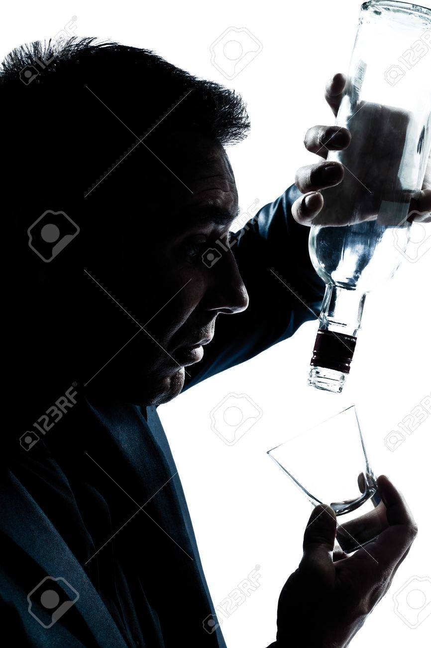 one caucasian man portrait silhouette drunk puring empty alcohol bottle in studio isolated white background Stock Photo - 11752595