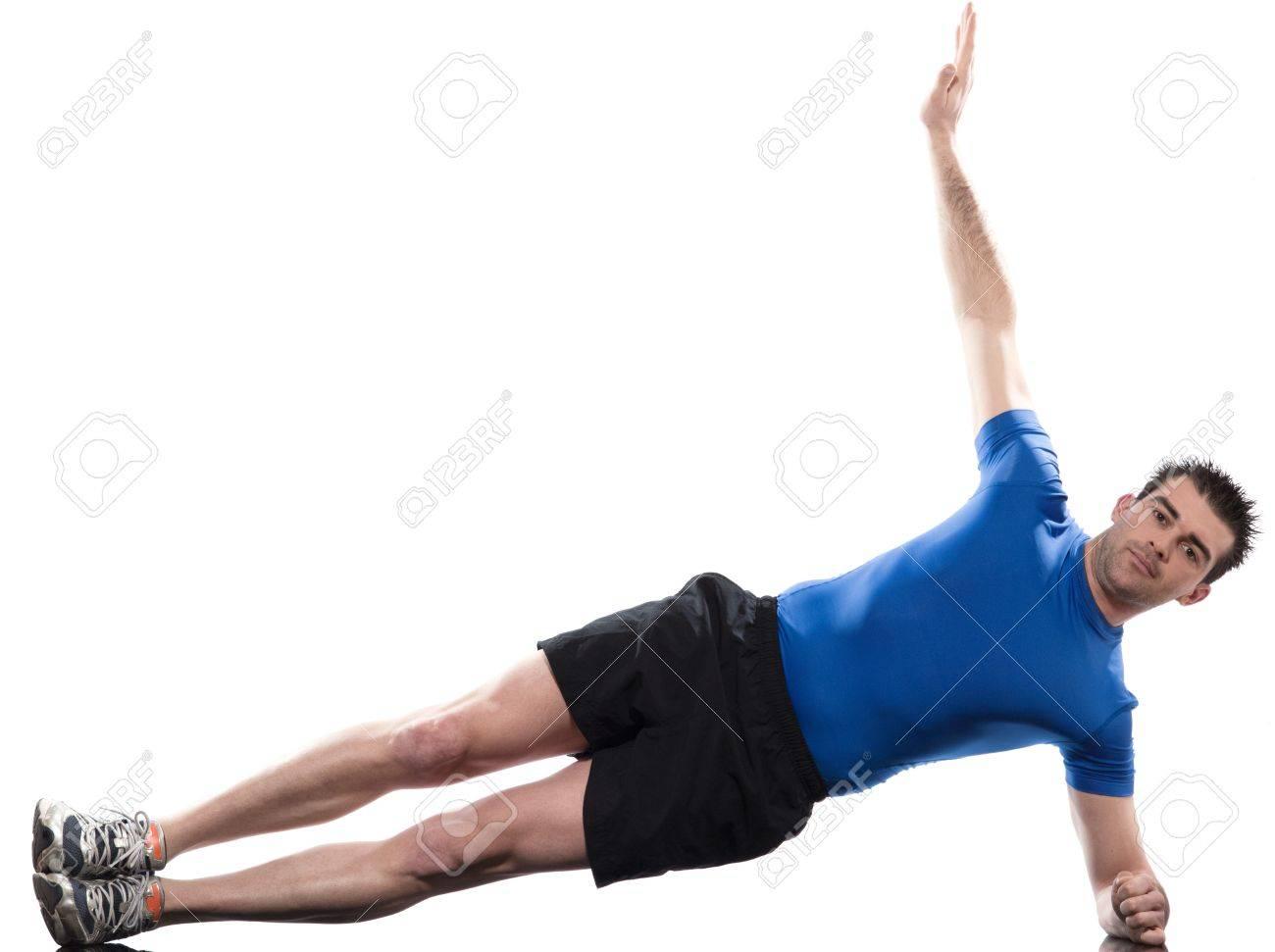 Foto de archivo - Hombre que yacía en postura lateral entrenamiento  Abdominales en estudio aislado de fondo blanco 294e48dff85e