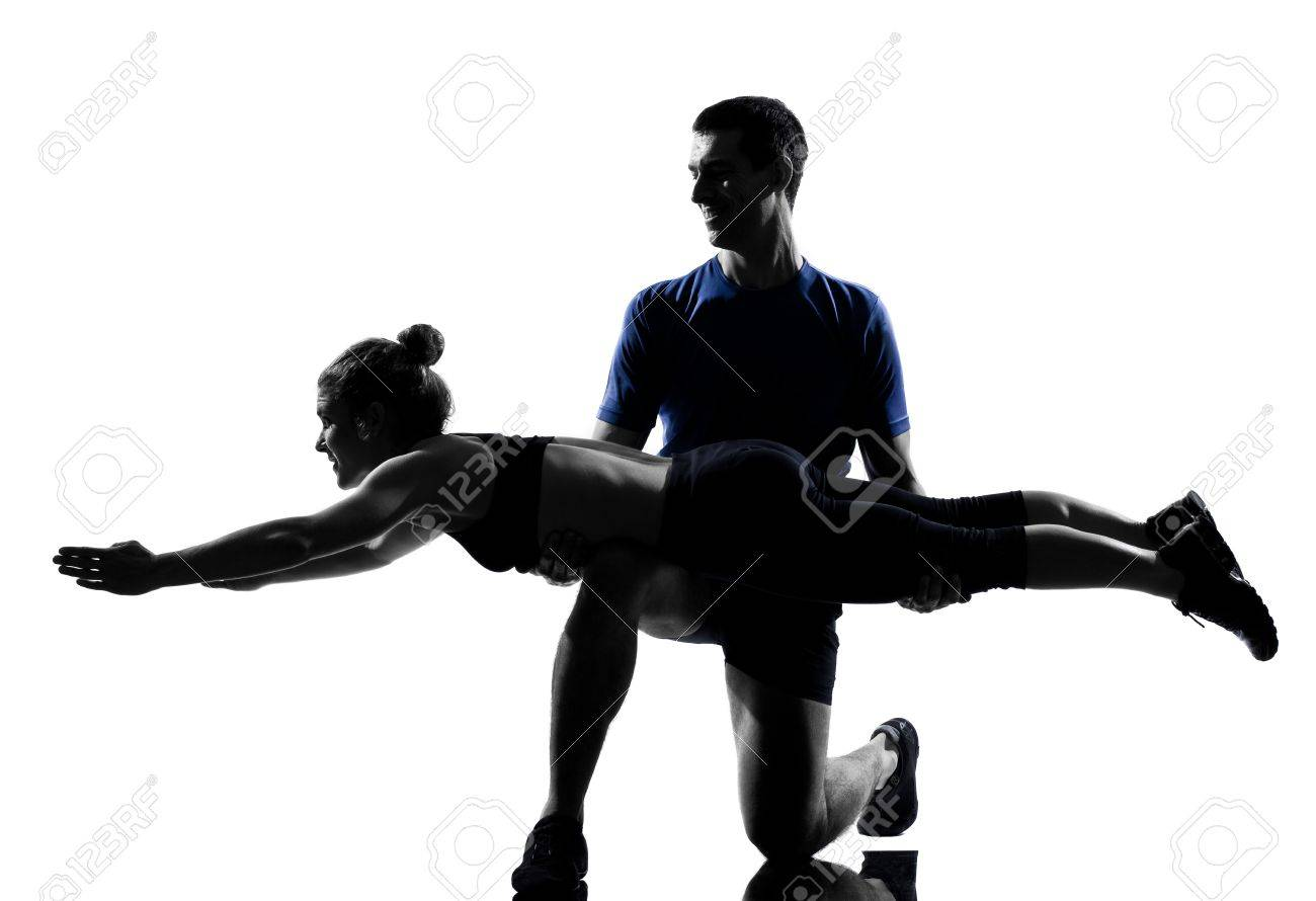 couple woman man exercising workout fitness aerobics posture in silhouette studio isolated on white background Stock Photo - 12896712