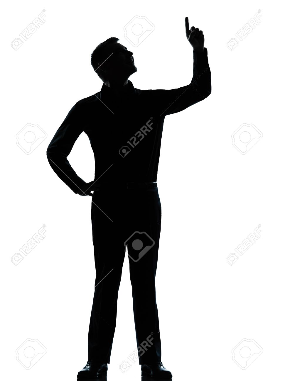 one caucasian business man poiting up happy  silhouette standing Full length in studio isolated on white background Stock Photo - 13339161