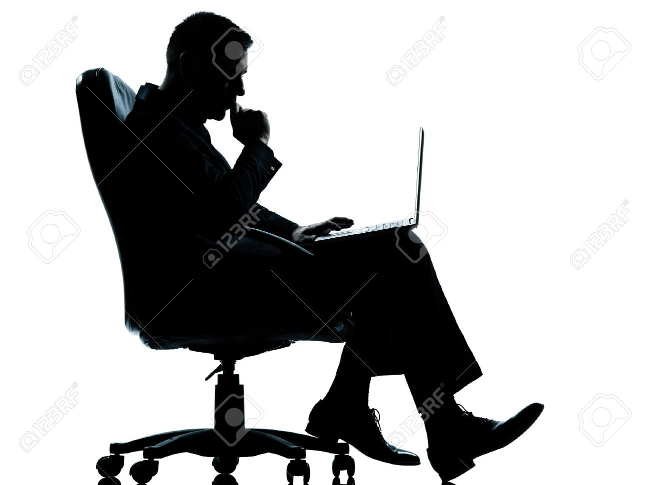 one caucasian business man computer computing serious sitting in armchair silhouette Full length in studio isolated on white background Stock Photo - 13339203