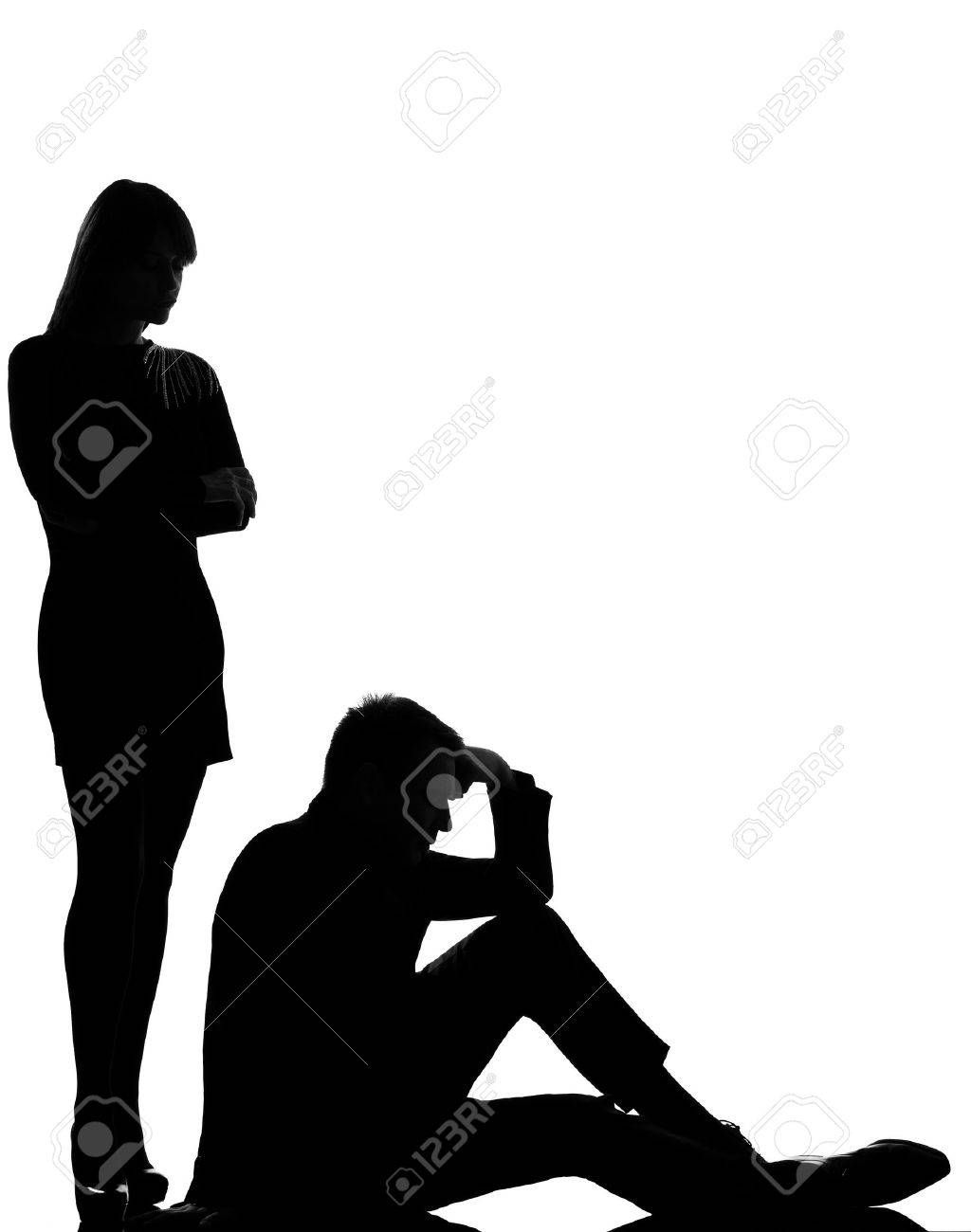 one caucasian couple man and woman dispute conflict full length in studio silhouette isolated on white background Stock Photo - 13134468