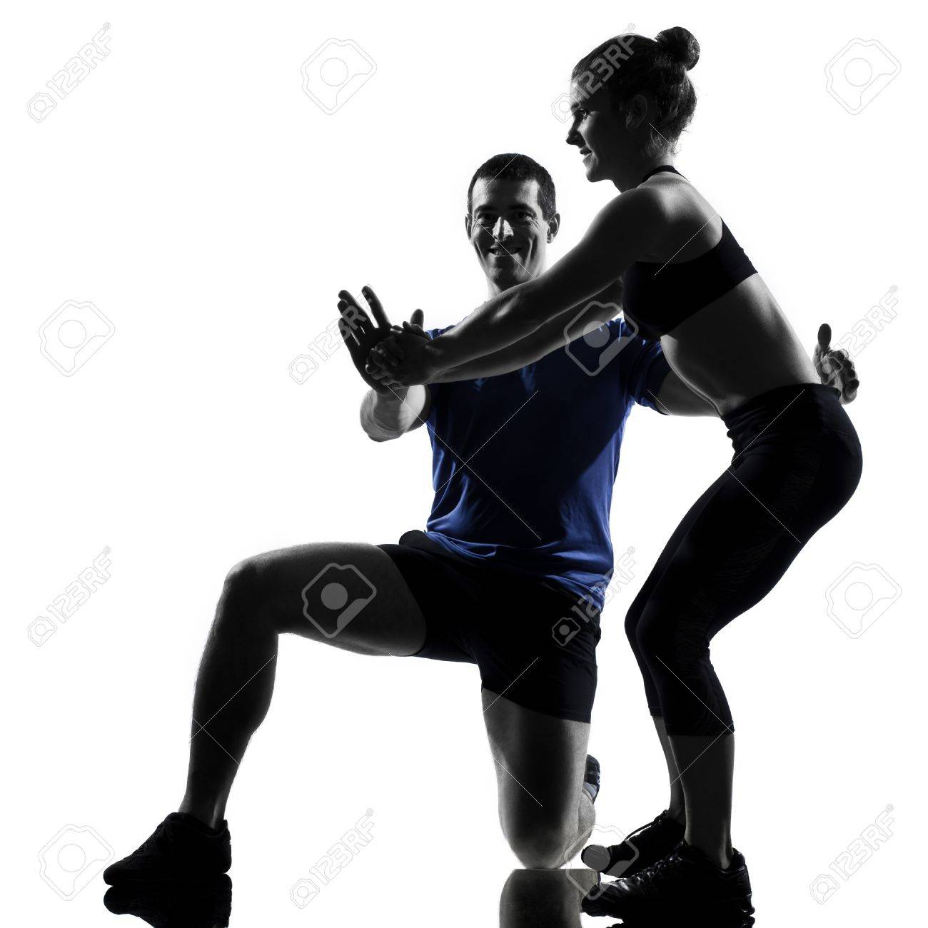 couple woman man exercising workout fitness aerobics posture in silhouette studio isolated on white background Stock Photo - 13339297
