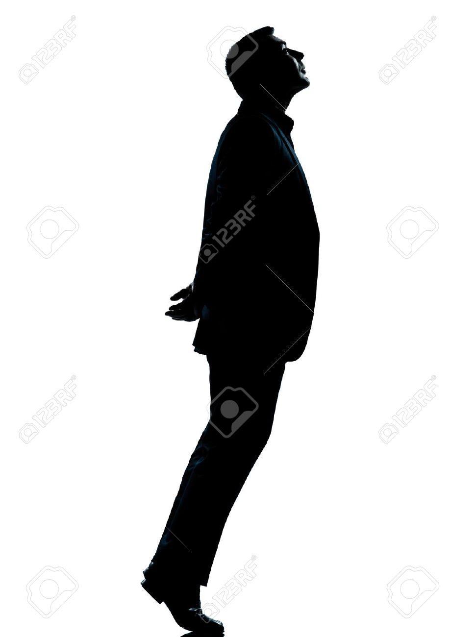 one caucasian business man silhouette standing tiptoe looking up Full length in studio isolated on white background Stock Photo - 13525169