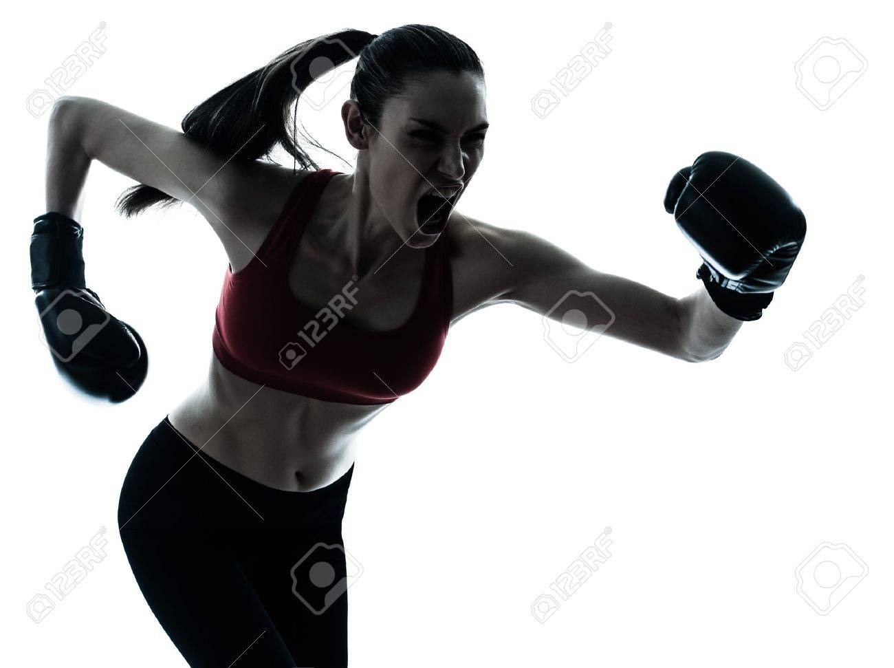 one caucasian woman boxing exercising in silhouette studio isolated isolated on white background Stock Photo - 13540114