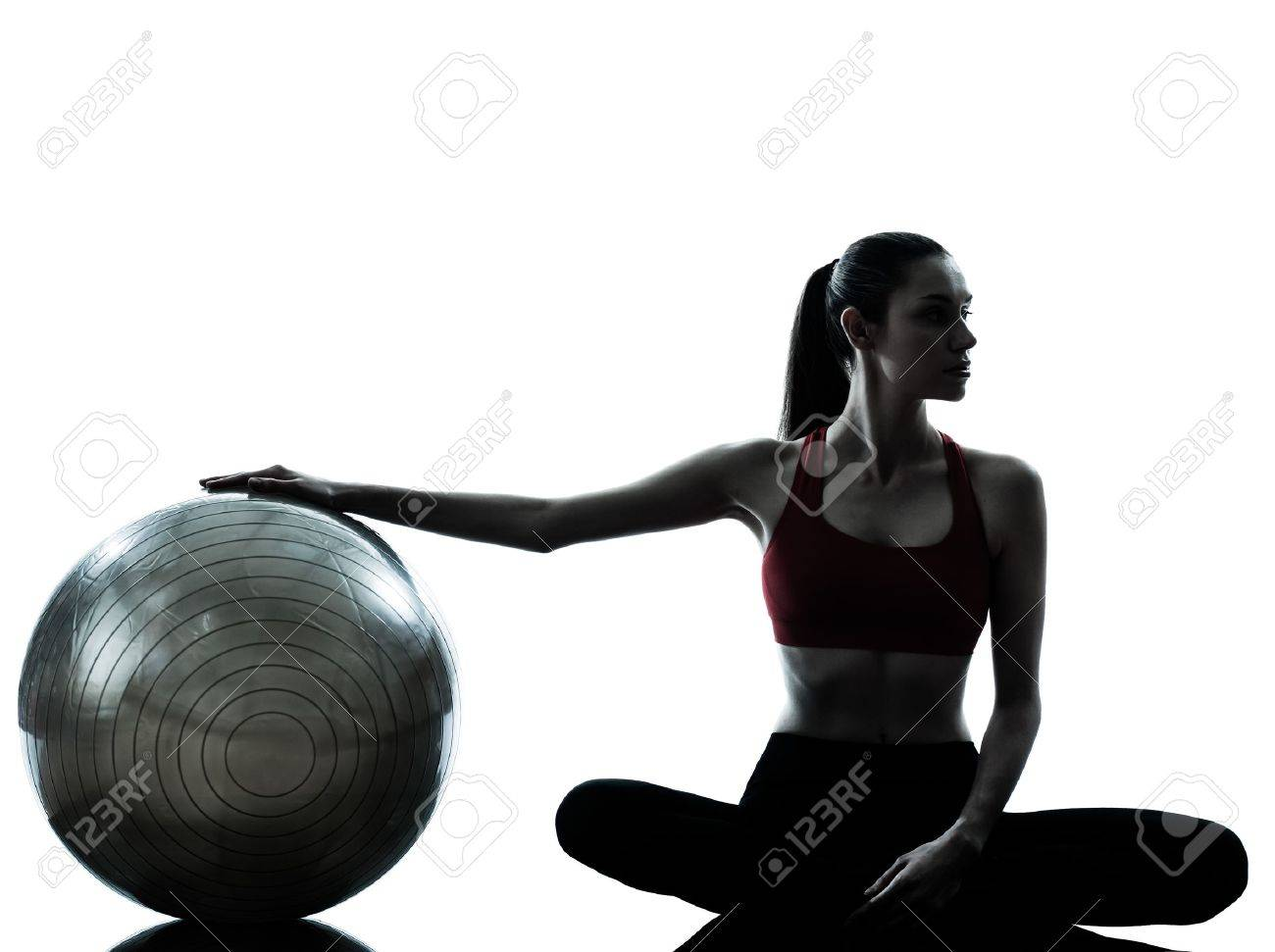 one caucasian woman exercising fitness ball in silhouette studio isolated on white background Stock Photo - 13543132