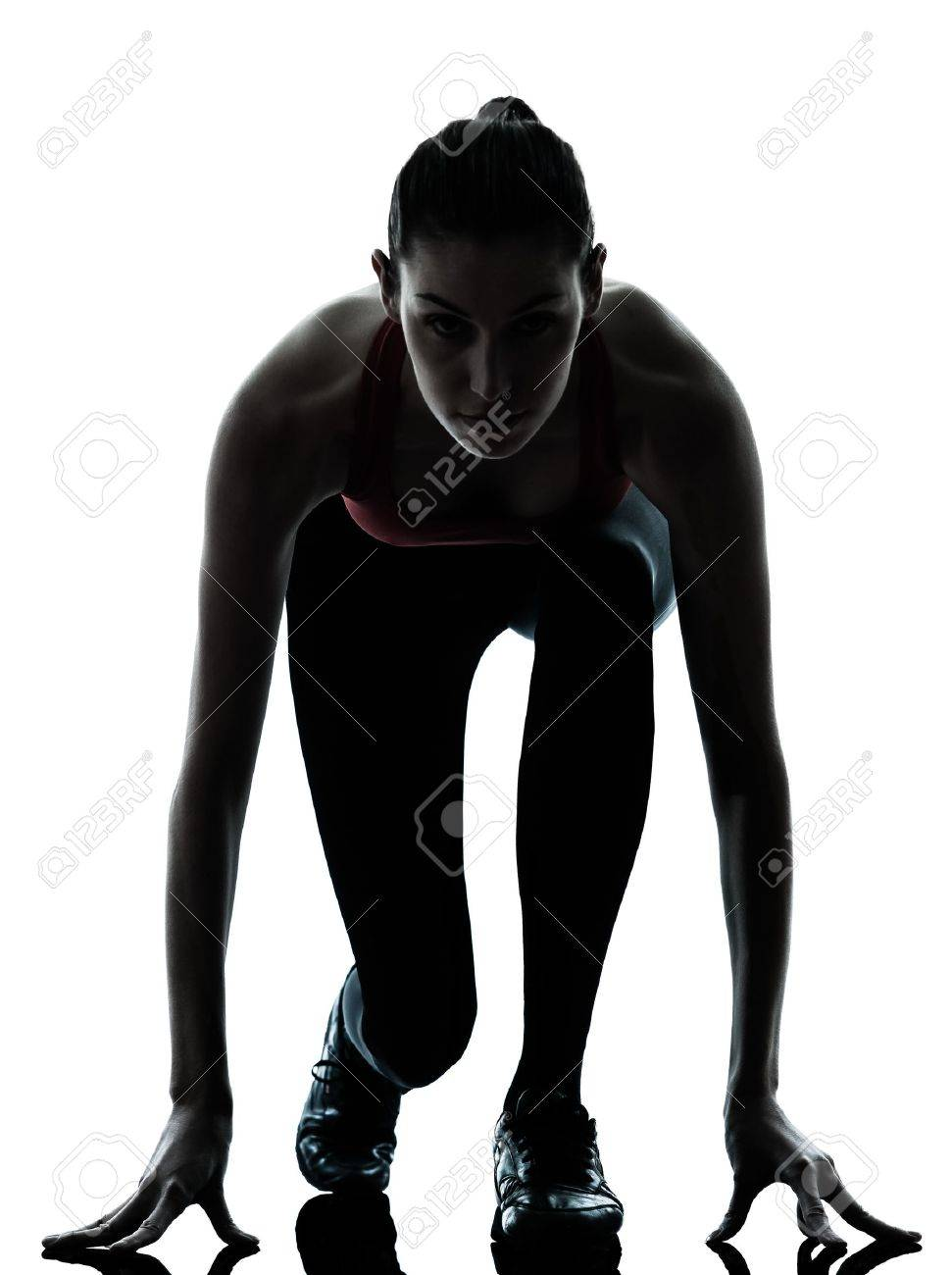 one caucasian woman sprinter on starting block in silhouette studio isolated on white background Stock Photo - 13543131