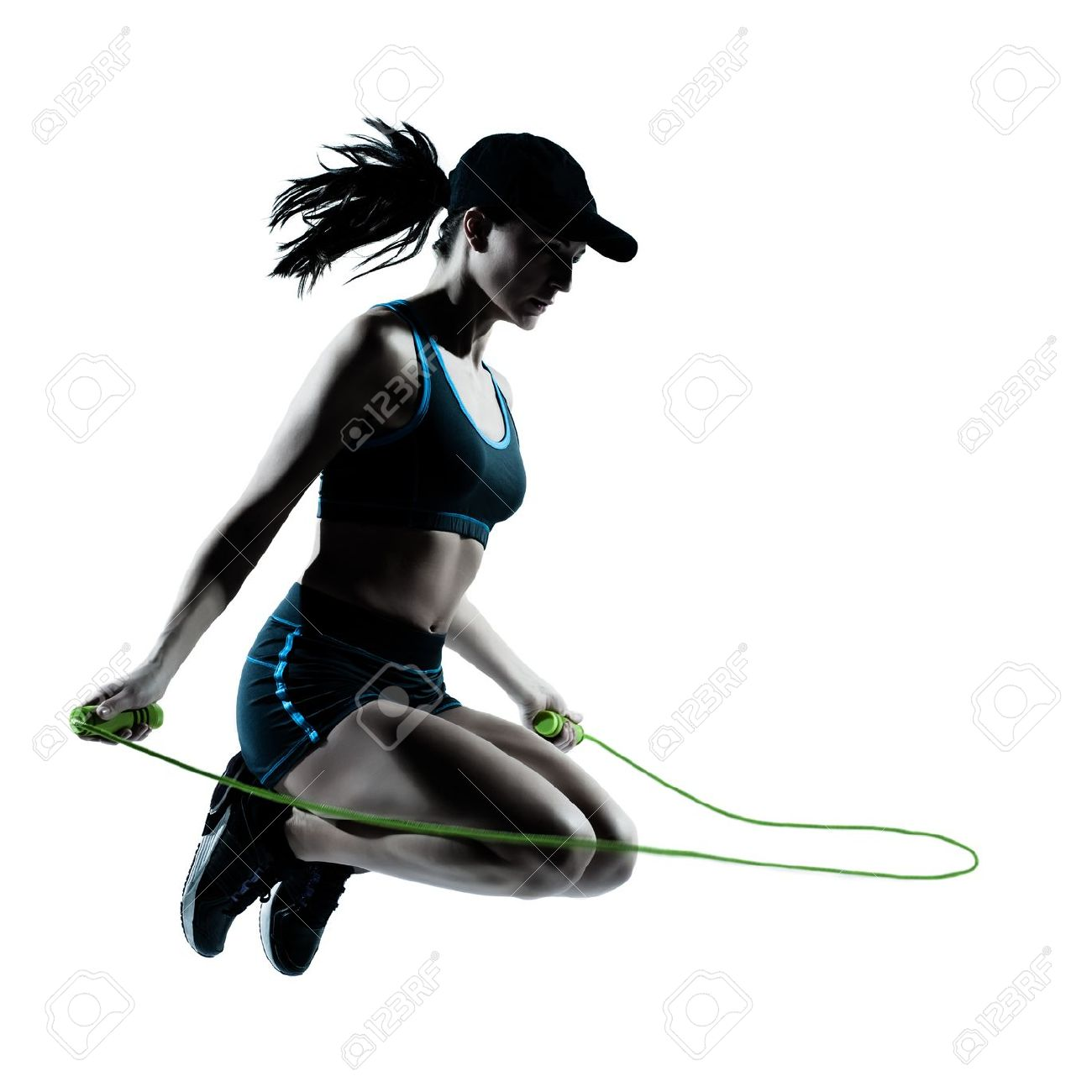 one caucasian woman runner jogger jumping rope in silhouette studio isolated on white background Stock Photo - 13543282
