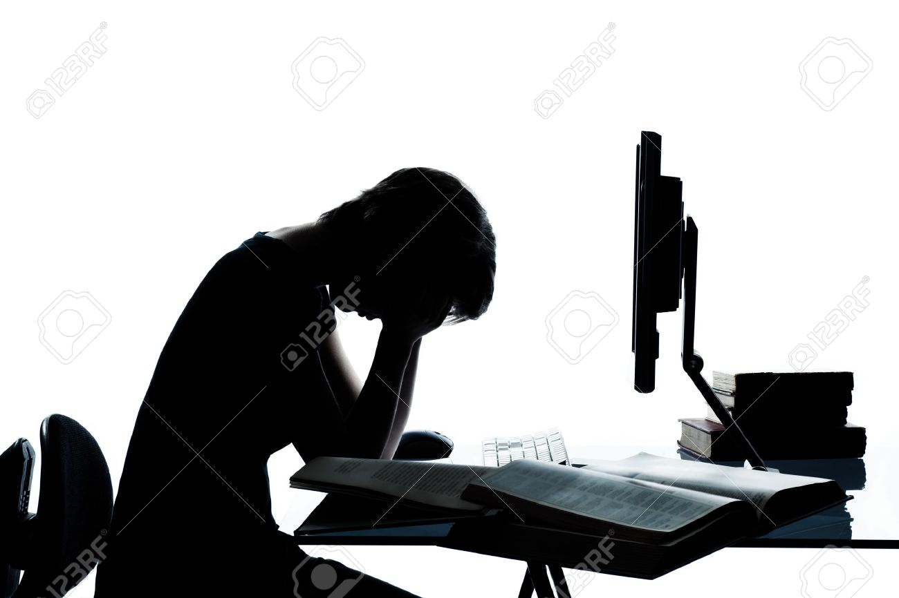 one caucasian young teenager silhouette boy or girl studying with computer computing laptop tired sad despair in studio cut out isolated on white background Stock Photo - 13525405