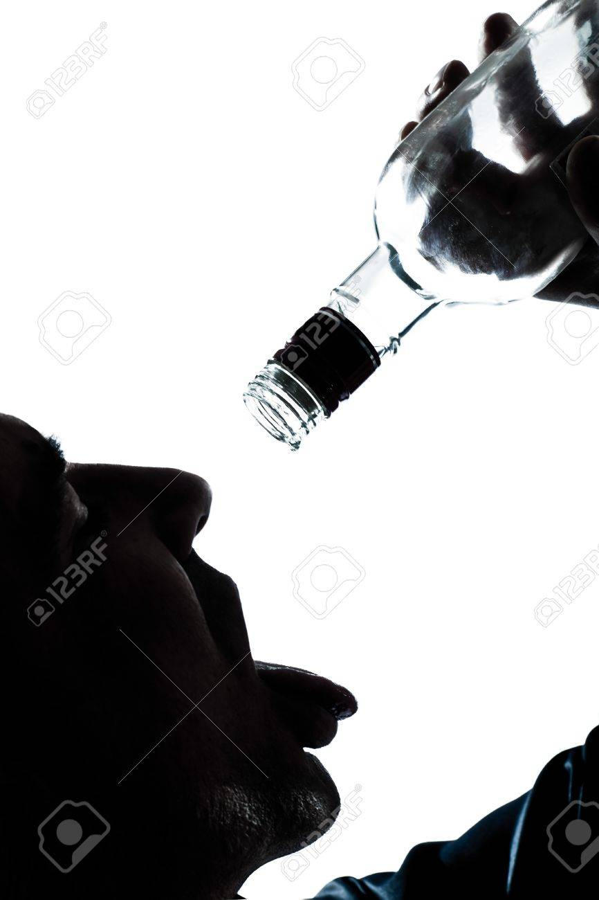 one caucasian man portrait silhouette drunk puring empty alcohol botlle in studio isolated white background Stock Photo - 13737991