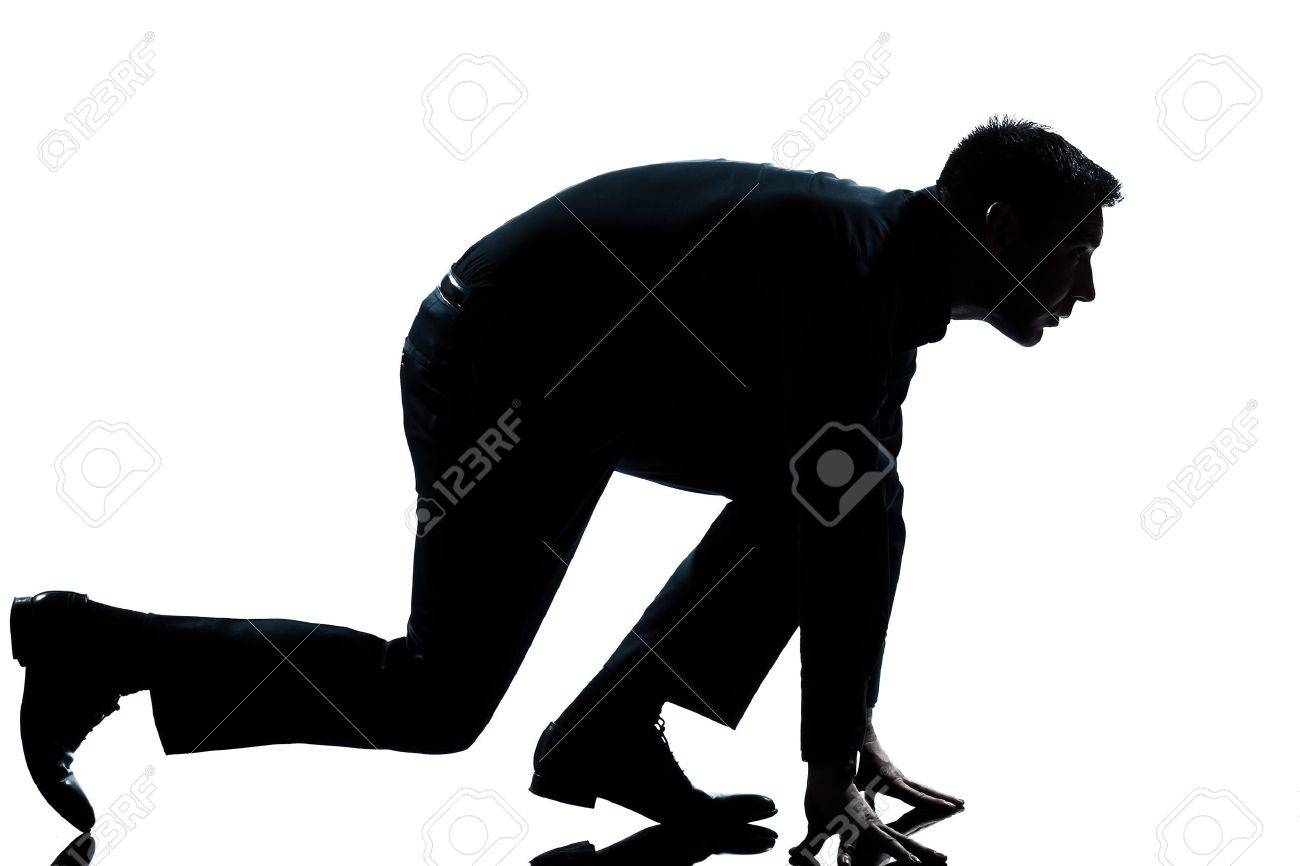 one caucasian man in starting block posture ready to run full length silhouette in studio isolated white background Stock Photo - 13888470