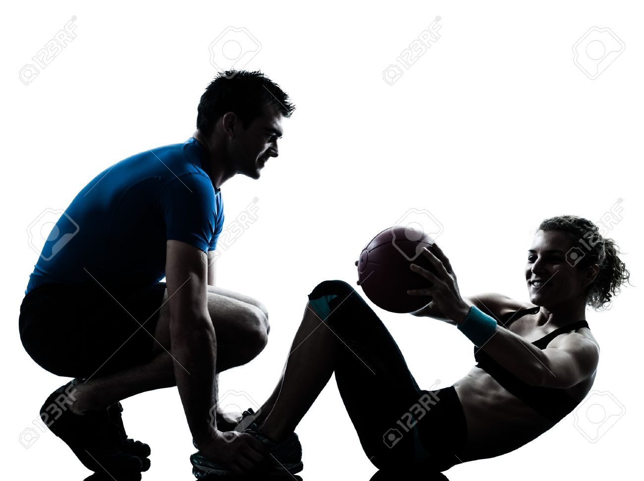 one caucasian couple man woman personal trainer coach exercising weights fitness ball silhouette studio isolated on white background Stock Photo - 14403120