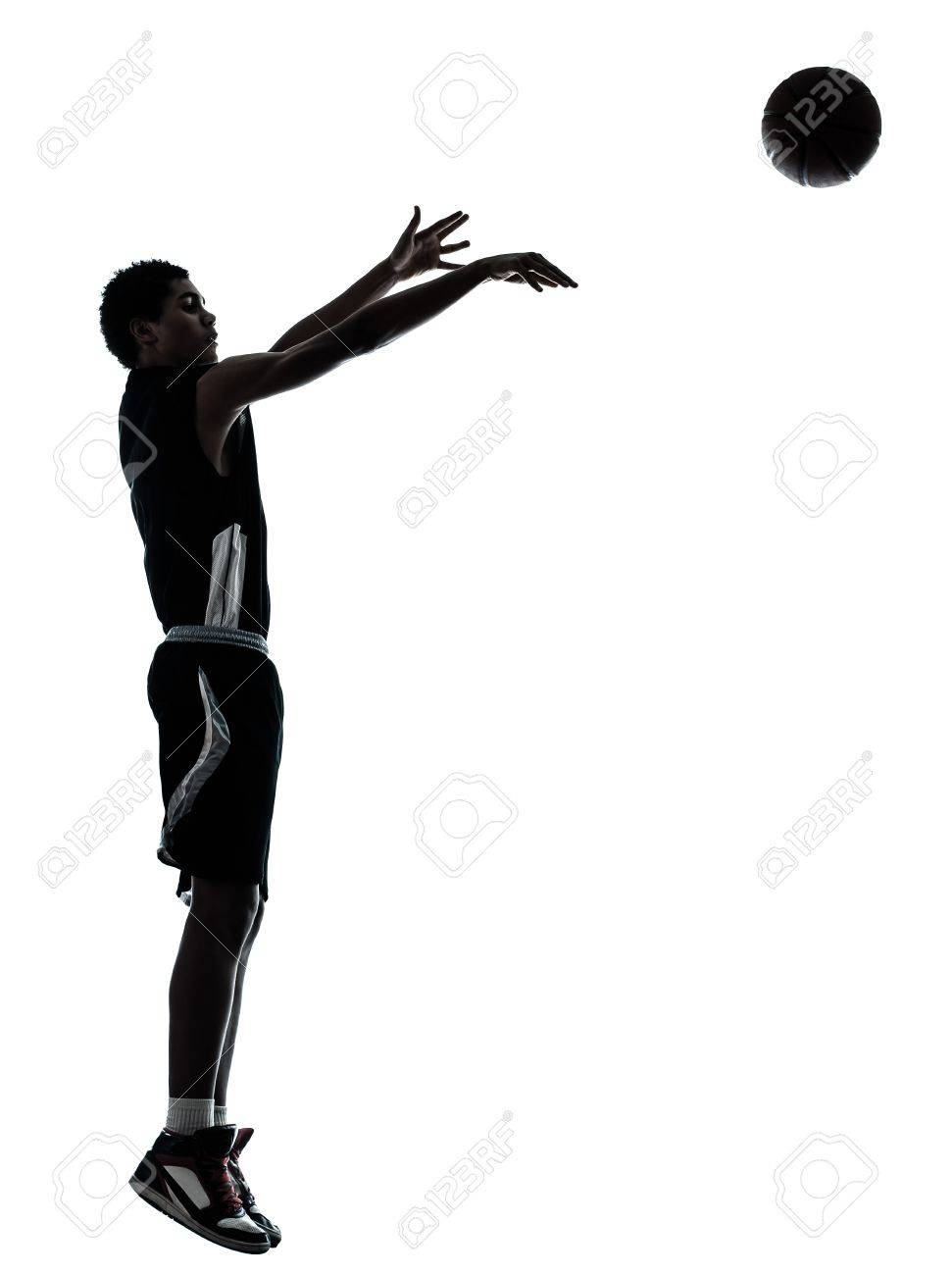one young man basketball player silhouette in studio isolated on white background Stock Photo - 14402765