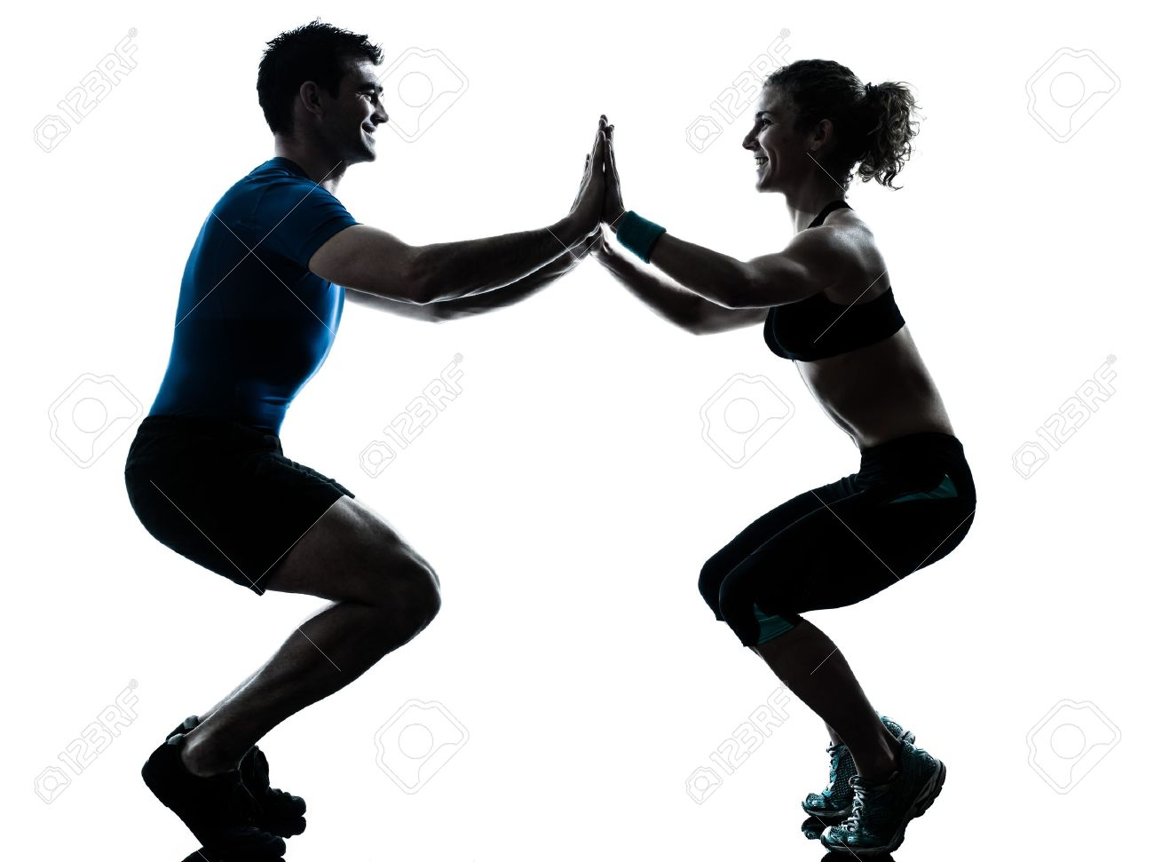 one caucasian couple man woman personal trainer coach exercising squatts silhouette studio isolated on white background Stock Photo - 14677452
