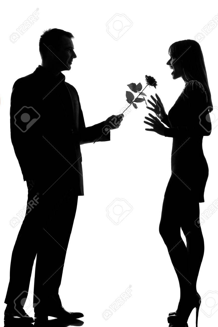 one caucasian lovers couple man offering rose flower and woman surprised in studio silhouette isolated on white background Stock Photo - 14683138