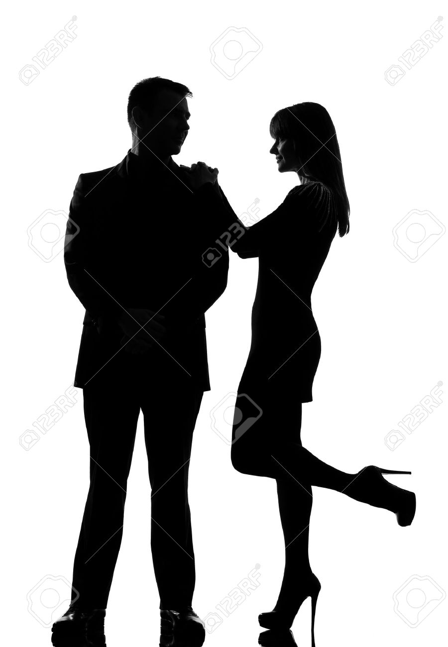 one caucasian couple man and woman standing face to face smiling in studio silhouette isolated on white background Stock Photo - 14683125