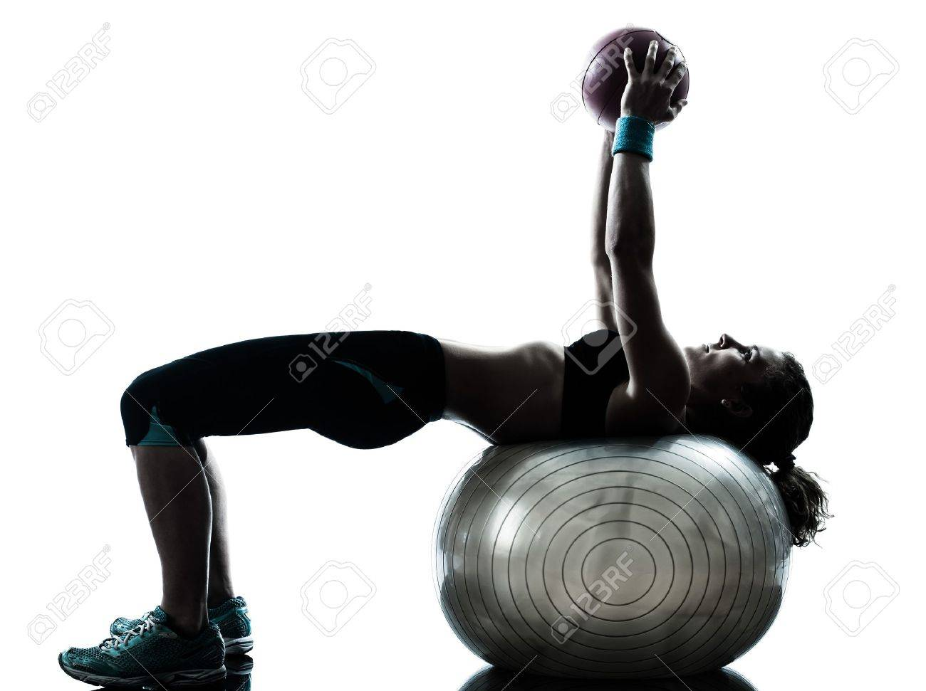 one caucasian woman exercising fitness ball workout posture in silhouette studio isolated on white background Stock Photo - 14683211