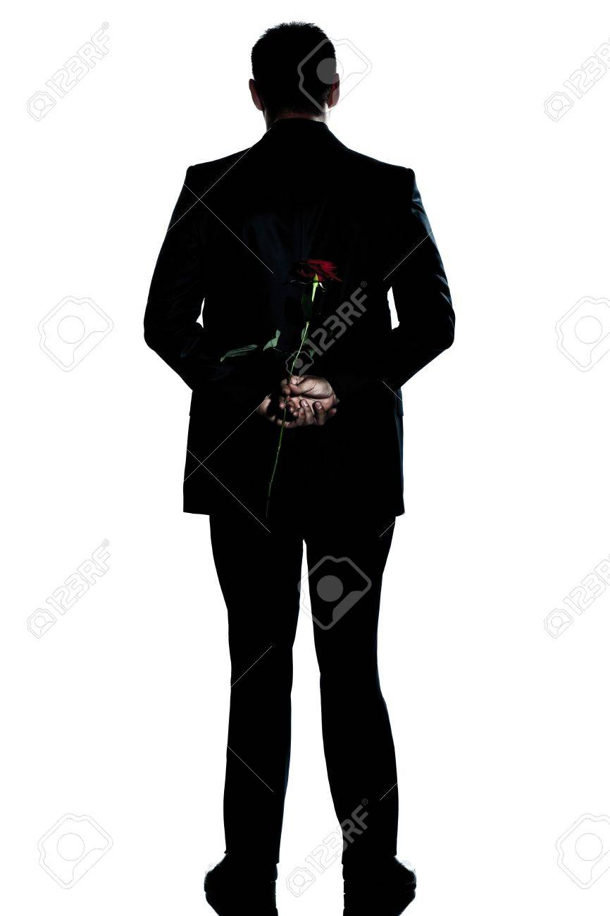 one caucasian backside man holding a rose flower  full length silhouette in studio isolated white background Stock Photo - 14677557