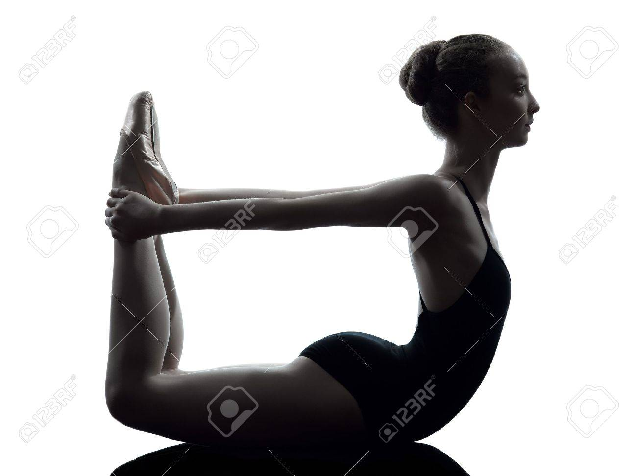 one caucasian young woman ballerina ballet dancer stretching warming up in silhouette studio on white background Stock Photo - 15089545