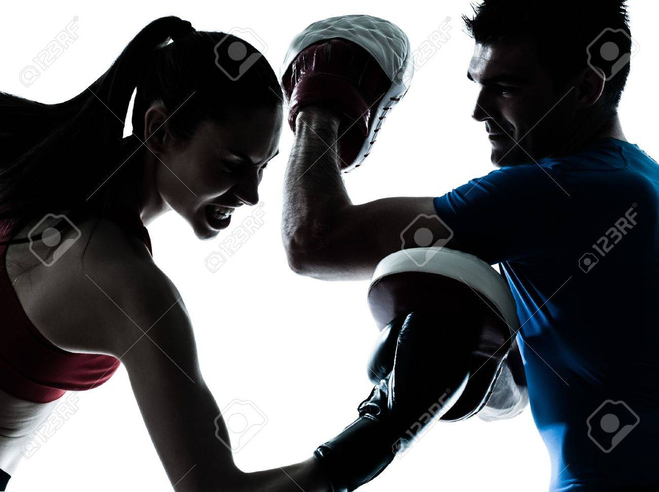 personal trainer man coach and woman exercising boxing silhouette  studio isolated on white background Stock Photo - 15482423