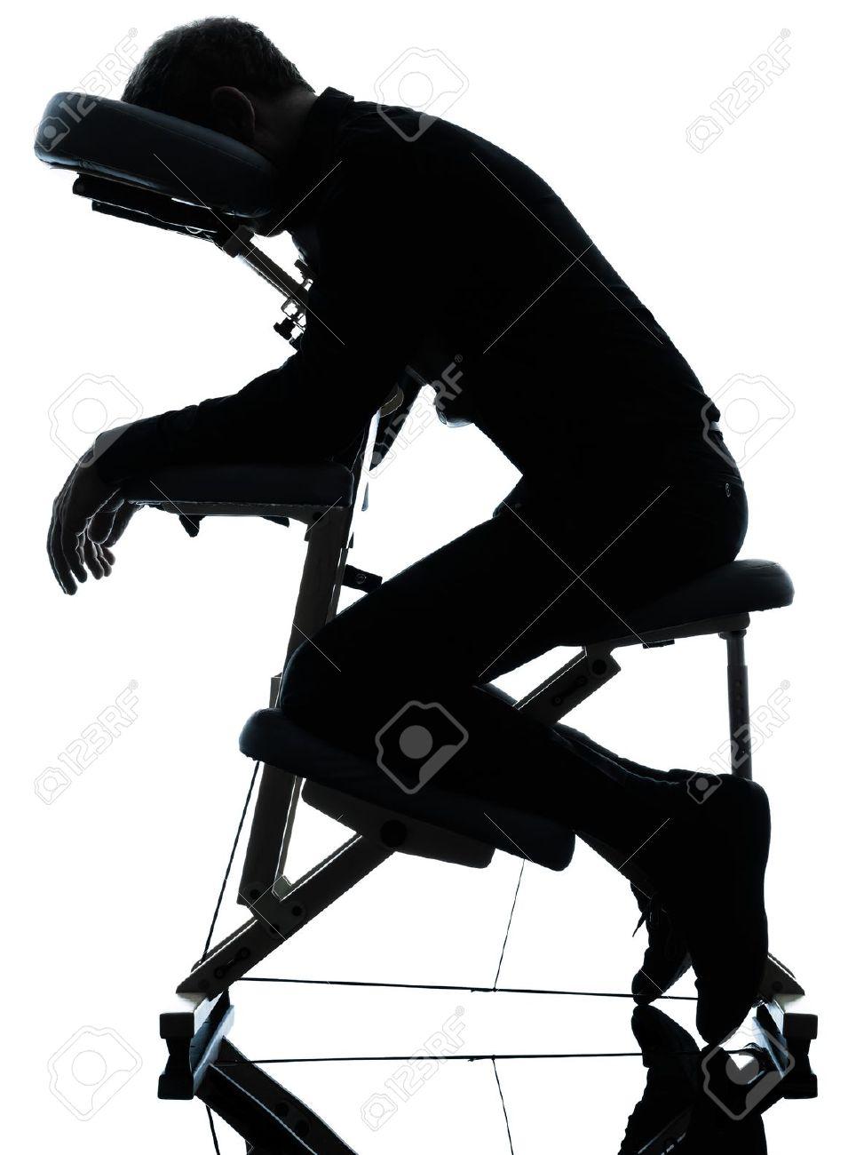chair massage. one man on chair massage in silhouette studio white background stock photo - 15480732
