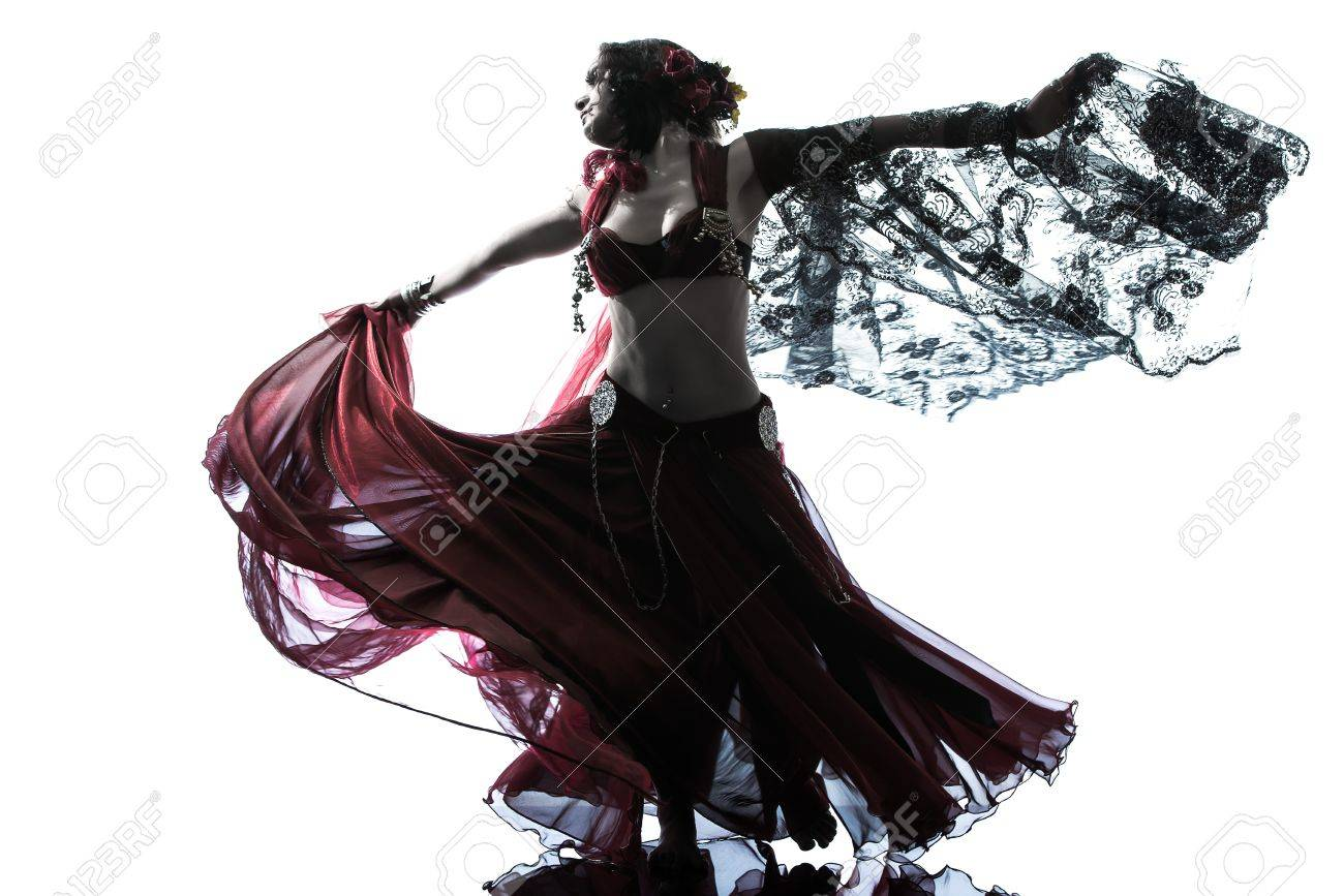 one arabic woman belly dancer dancing silhouette studio isolated on white background Stock Photo - 15464882