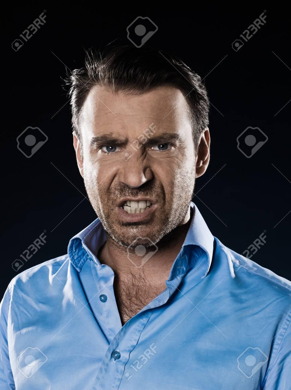 caucasian man unshaven pucker anger portrait isolated studio on black background Stock Photo - 15641305