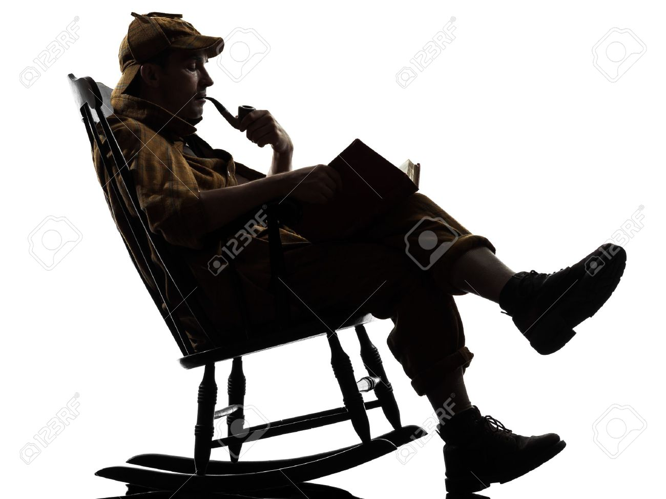 Attrayant Sherlock Holmes Reading Silhouette Sitting In Rocking Chair In Studio On  White Background Stock Photo