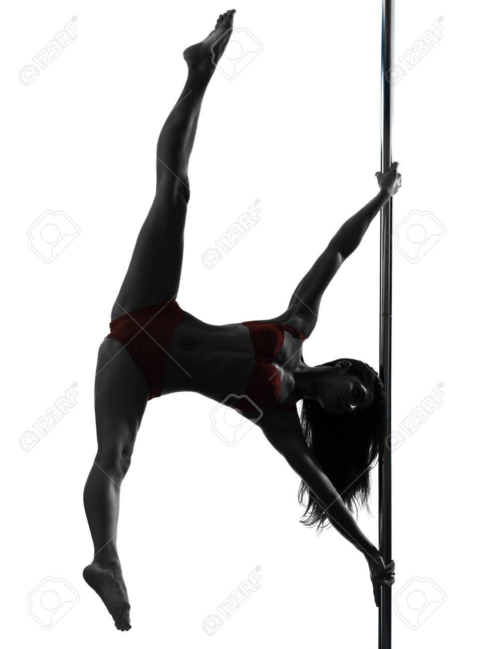 one caucasian woman pole dancer dancing in silhouette studio isolated on white background Stock Photo - 16391770
