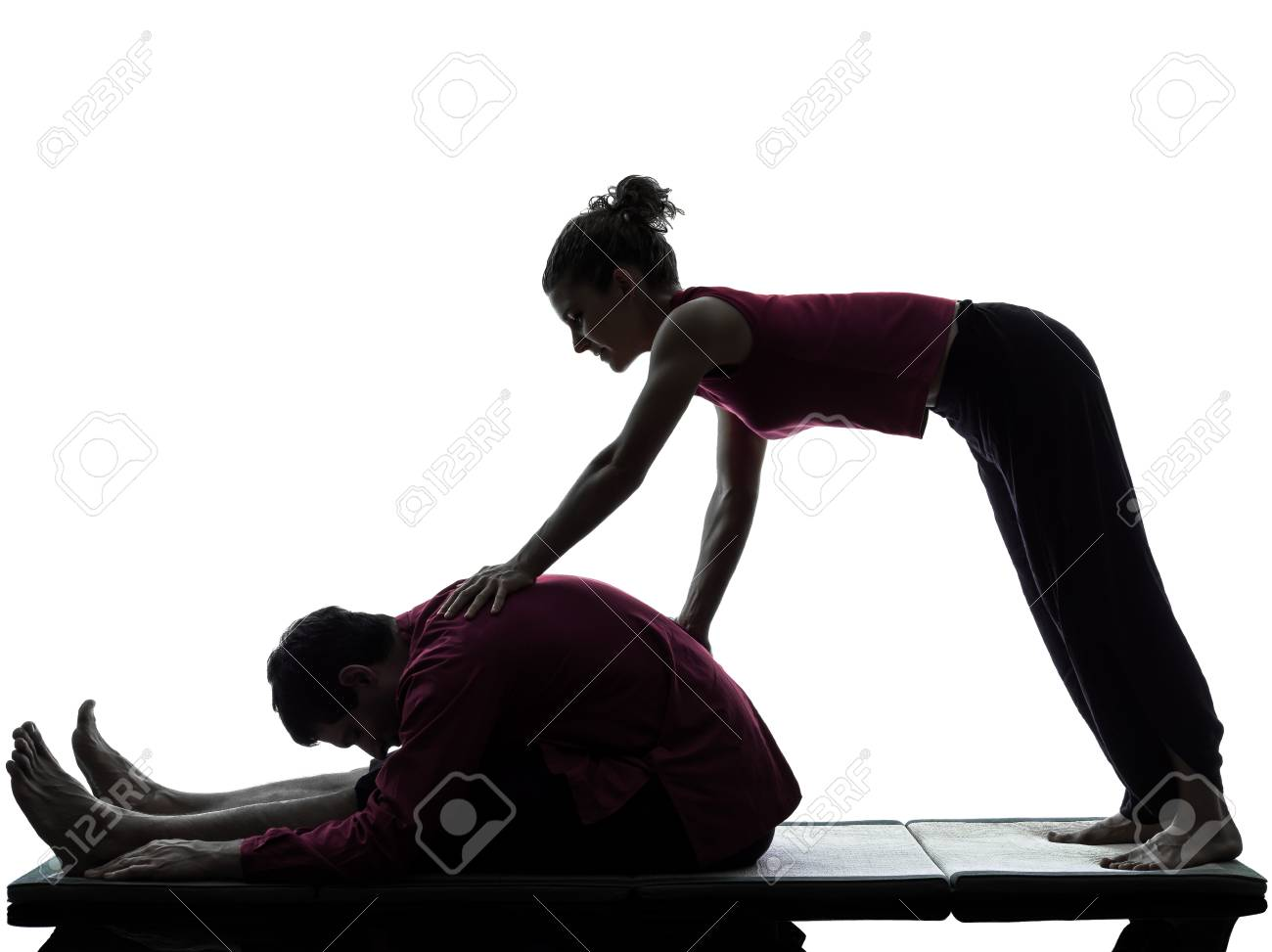 one man and woman perfoming thai massage in silhouette studio on white background Stock Photo - 16545410