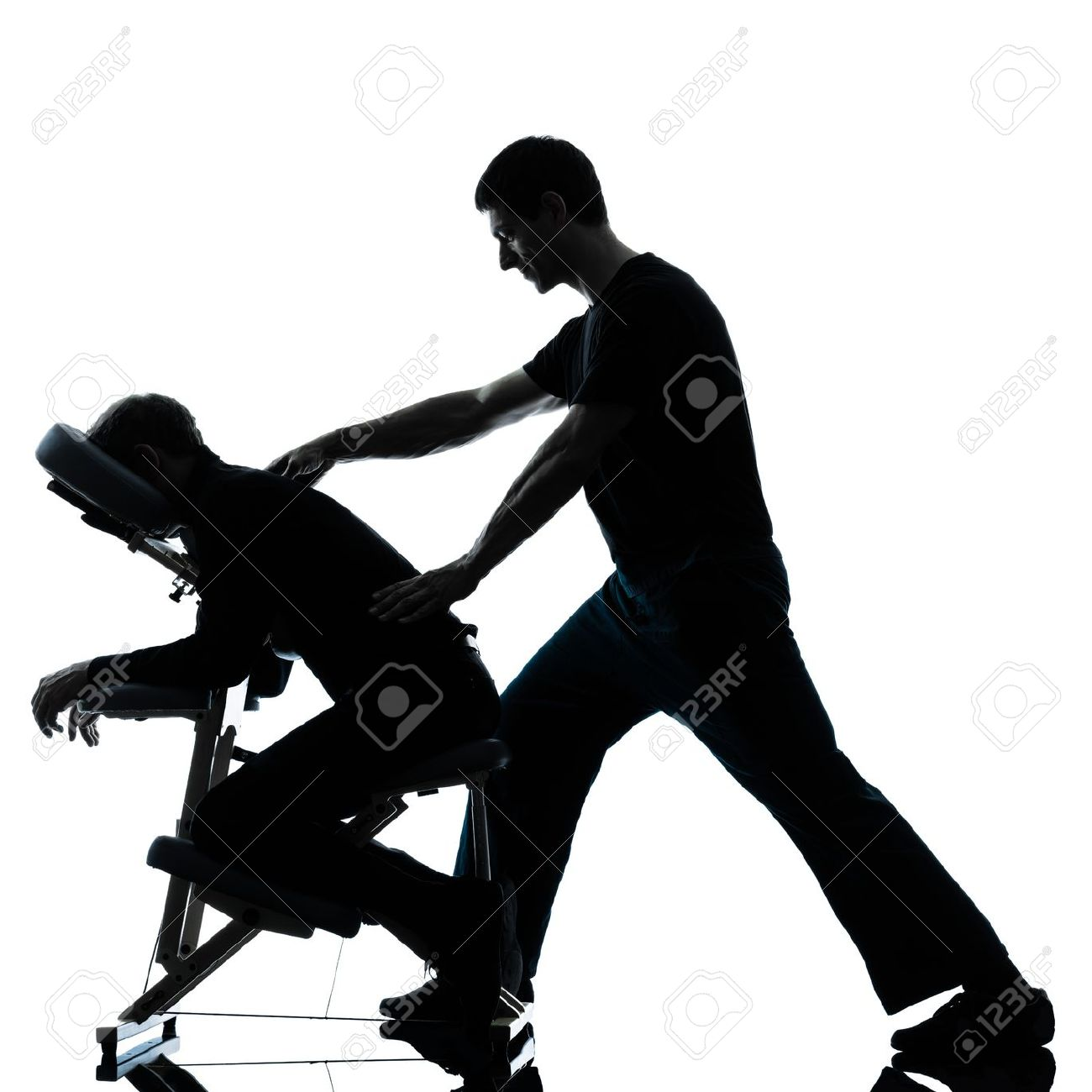 Chair massage therapy - Massage Therapy Two Men Performing Chair Back Massage In Silhouette Studio On White Background