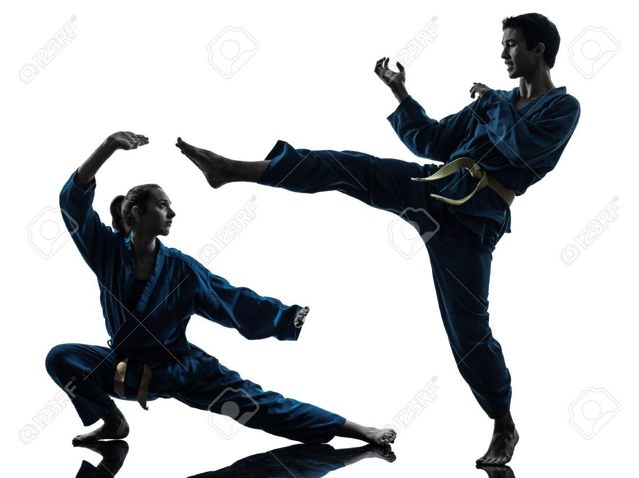 one  man woman couple exercising karate vietvodao martial arts in silhouette studio isolated on white background Stock Photo - 16716016