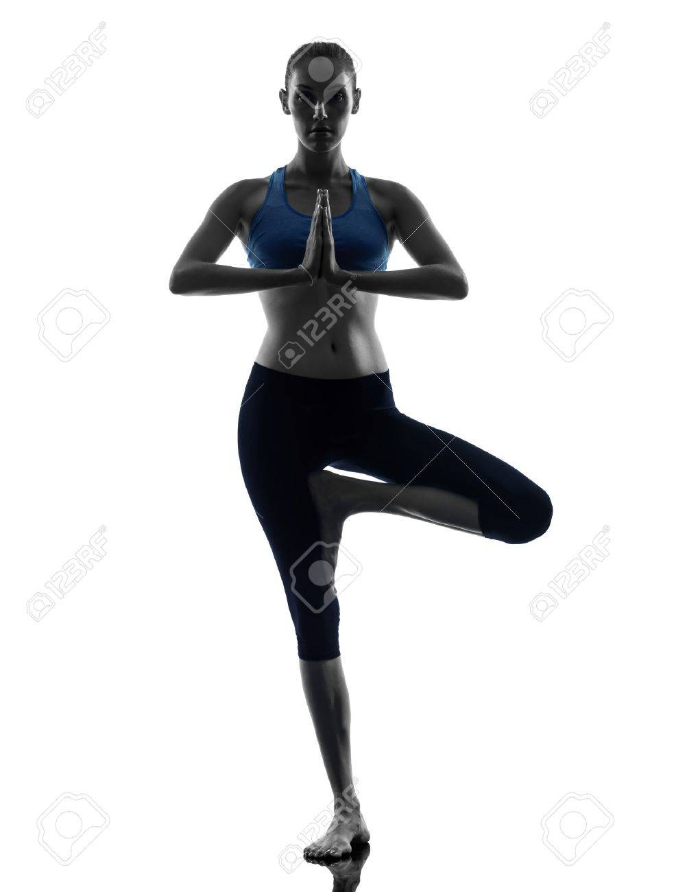 one caucasian woman exercising yoga tree pose in silhouette studio isolated on white background Stock Photo - 16692014