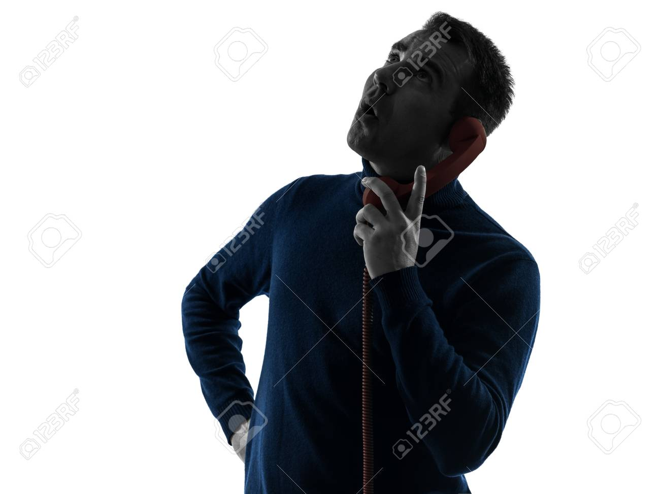 one caucasian man surprised on the phone portrait in silhouette studio isolated on white background Stock Photo - 17419805