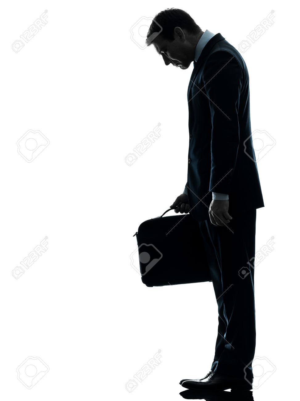 one caucasian sad business man  looking down  in silhouette studio isolated on white background Stock Photo - 17798127