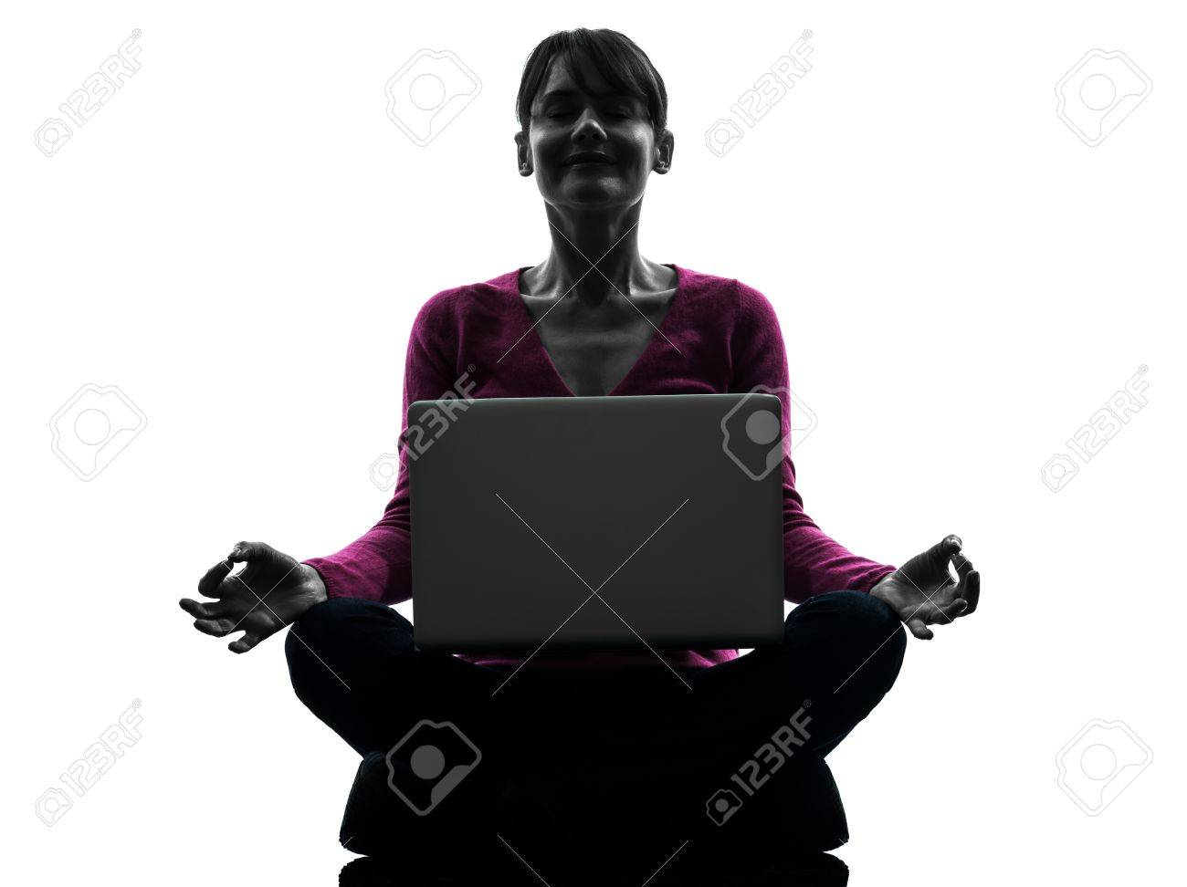 one caucasian woman lotus posture  computing laptop computer  in silhouette studio isolated on white background Stock Photo - 18353496